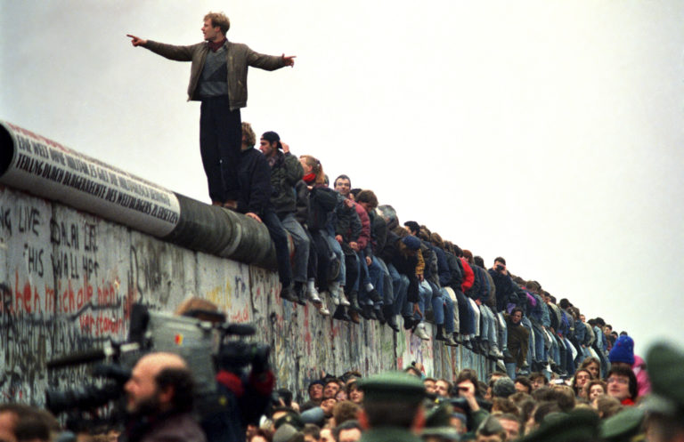 WEST BERLIN - NOVEMBER 11: People stand on a section of the Berlin Wall at Potsdamer Platz. (Photo by John Tlumacki/The Boston Globe via Getty Images)