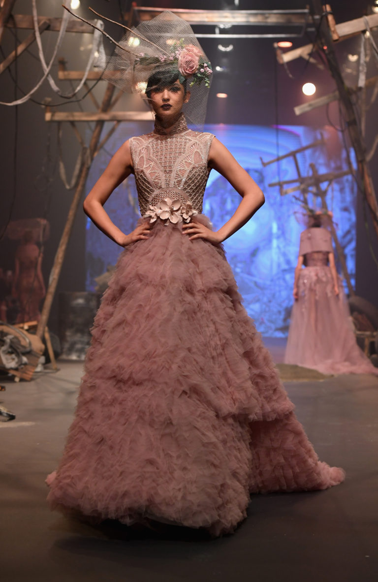 A model walks the runway during the Amato show at Fashion Forward March 2017 held at the Dubai Design District on March 25, 2017 in Dubai, United Arab Emirates.